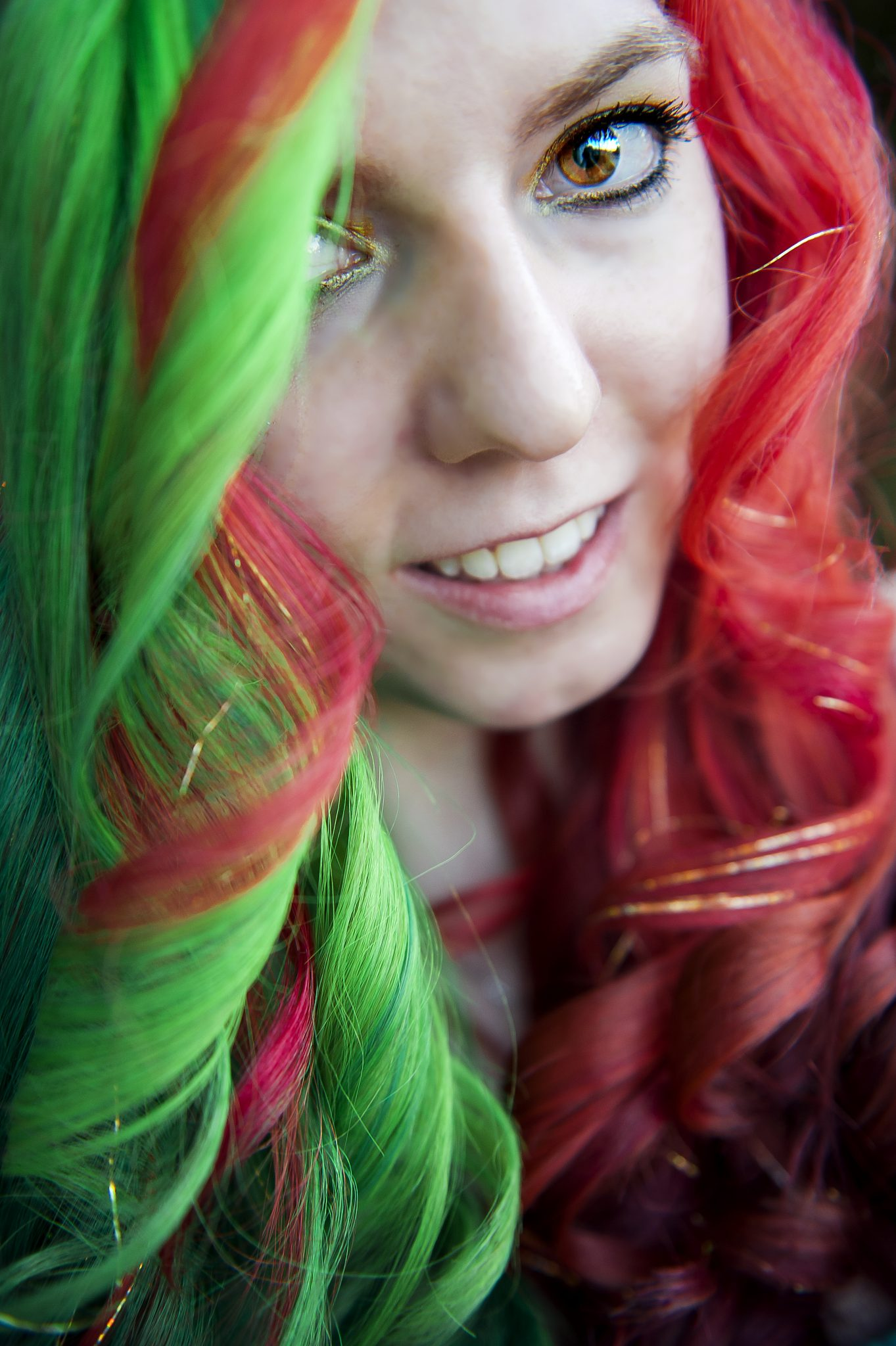 curled half green and half red hair dyed for christmas with gold tinsel